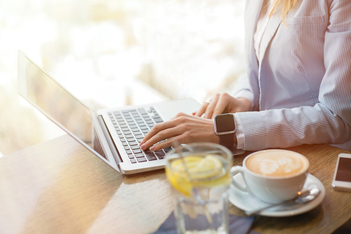 Woman in cafe working on computer